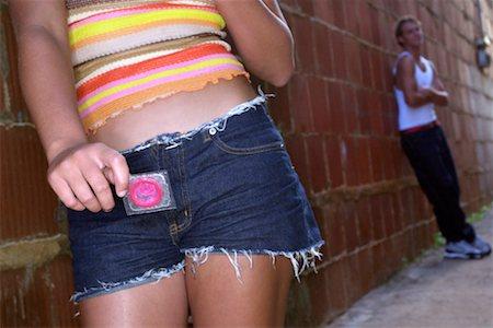 Woman with condom Stock Photo - Premium Royalty-Free, Code: 604-00229624