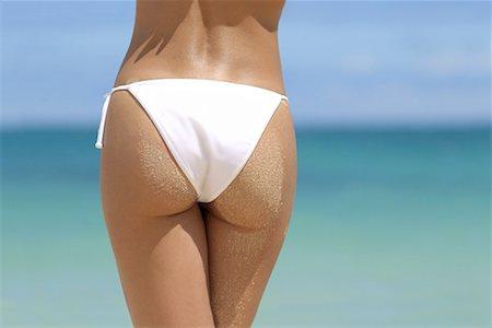 female rear end - Buttocks of woman wearing bikini/ Stock Photo - Premium Royalty-Free, Code: 604-00234121