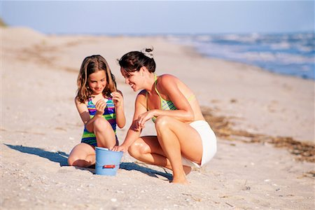 preteen girls bath - Mother and daughter on beach Stock Photo - Premium Royalty-Free, Code: 604-00230907
