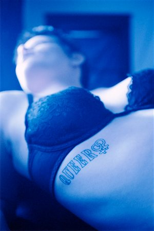Woman with tattoo Stock Photo - Premium Royalty-Free, Code: 604-00231346
