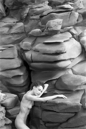 Nude woman by rocks Stock Photo - Premium Royalty-Free, Code: 604-00231411