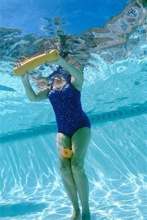 seniors woman in swimsuit - Woman swimming Stock Photo - Premium Royalty-Free, Code: 604-00231760