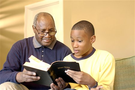 Grandfather and grandson reading Bible Stock Photo - Premium Royalty-Free, Code: 604-00232753