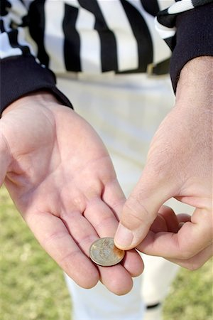 Referees hands with coin/ Stock Photo - Premium Royalty-Free, Code: 604-00233758