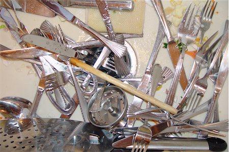 Dirty silverware in sink Stock Photo - Premium Royalty-Free, Code: 604-00233845