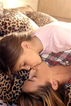 preteen kissing - Mother and daughter kissing/ Stock Photo - Premium Royalty-Free, Code: 604-00233879