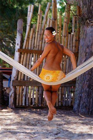 Woman sitting on hammock Stock Photo - Premium Royalty-Free, Code: 604-00275135