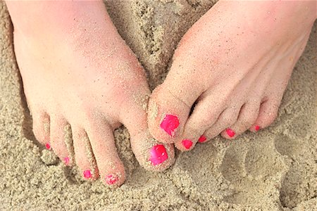 Feet in sand Stock Photo - Premium Royalty-Free, Code: 604-00275950