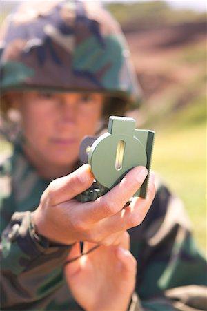 scope - Soldier using compass scope Stock Photo - Premium Royalty-Free, Code: 604-00276338