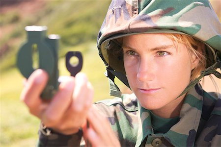 scope - Soldier looking through compass scope Stock Photo - Premium Royalty-Free, Code: 604-00276339