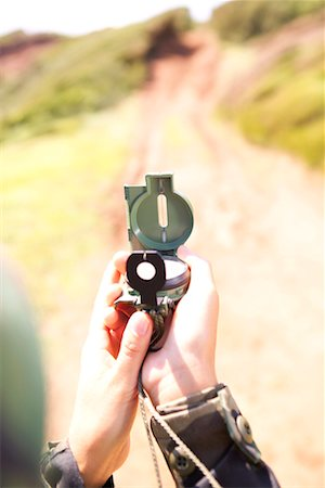 scope - Hands of soldier using compass scope Stock Photo - Premium Royalty-Free, Code: 604-00276340