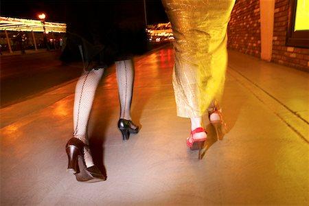stocking feet - Legs of women at night/ Stock Photo - Premium Royalty-Free, Code: 604-00278071