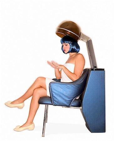 retro beauty salon images - Woman under salon hair dryer/ Stock Photo - Premium Royalty-Free, Code: 604-00278510