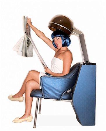 retro beauty salon images - Woman reading magazine under salon hair dryer/ Stock Photo - Premium Royalty-Free, Code: 604-00278511