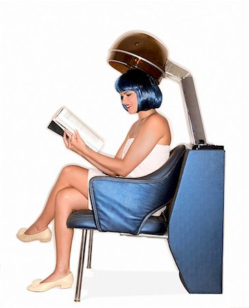 retro beauty salon images - Woman reading magazine under salon hair dryer/ Stock Photo - Premium Royalty-Free, Code: 604-00278512