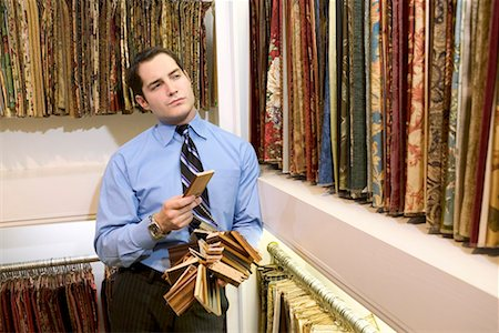 Man with samples in furniture store/ Stock Photo - Premium Royalty-Free, Code: 604-00278803