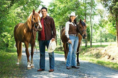 Couple with horses Stock Photo - Premium Royalty-Free, Code: 604-00754344