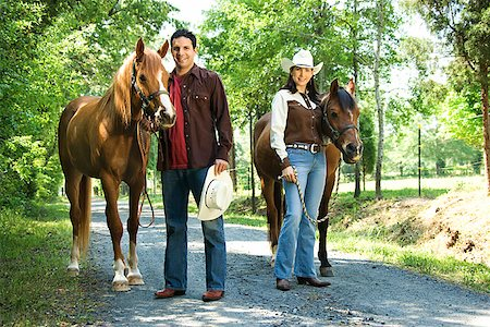 Couple with horses Stock Photo - Premium Royalty-Free, Code: 604-00754344