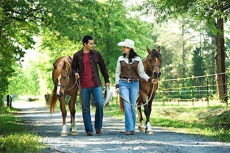 Couple with horses Stock Photo - Premium Royalty-Free, Code: 604-00754343