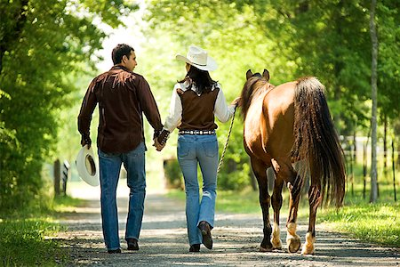 Couple with horse holding hands Stock Photo - Premium Royalty-Free, Code: 604-00754351