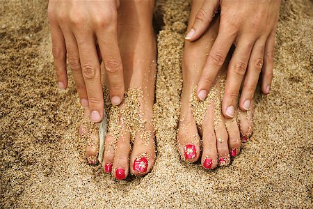 foot model - Feet and hands in sand/ Stock Photo - Premium Royalty-Free, Code: 604-00755025