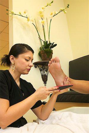 foot model - Woman giving pedicure Stock Photo - Premium Royalty-Free, Code: 604-00755065