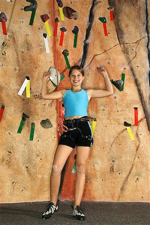 Teenage girl by rock climbing wall Stock Photo - Premium Royalty-Free, Code: 604-00755202