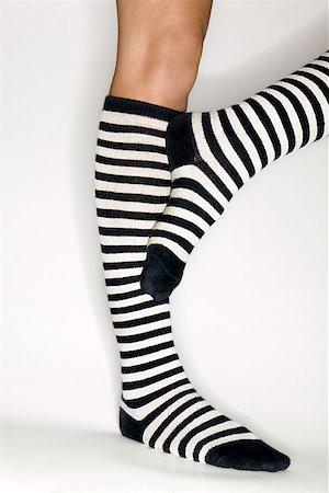 stocking feet - Striped socks Stock Photo - Premium Royalty-Free, Code: 604-00757589