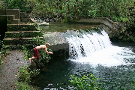 Boy diving in river Stock Photo - Premium Royalty-Free, Code: 604-00757794