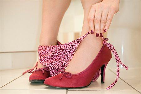 Woman pulling up panties Stock Photo - Premium Royalty-Free, Code: 604-00757895