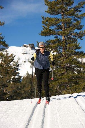 Woman cross-country skiing Stock Photo - Premium Royalty-Free, Code: 604-00753732