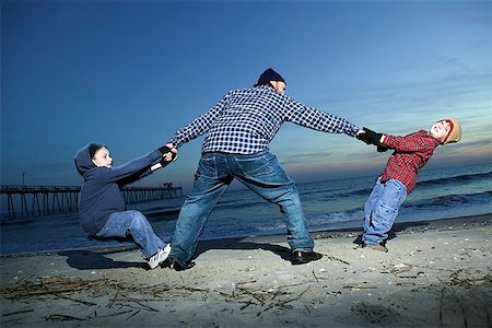 pre-teen boy models - Father playing with children at beach Stock Photo - Premium Royalty-Free, Code: 604-00760215