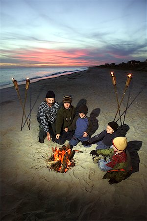 pre-teen boy models - Family around campfire on beach Stock Photo - Premium Royalty-Free, Code: 604-00760219