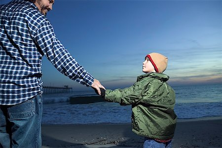 pre-teen boy models - Father and son holding hands on beach Stock Photo - Premium Royalty-Free, Code: 604-00760213