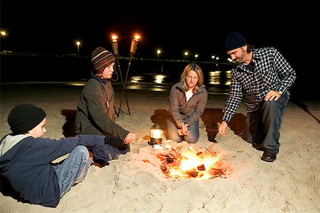 pre-teen boy models - Family around campfire on beach Stock Photo - Premium Royalty-Free, Code: 604-00760232