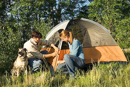 Couple with dog camping/ Stock Photo - Premium Royalty-Free, Code: 604-00937340