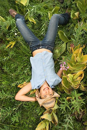 preteen  smile  one  alone - Teenage girl lying down outdoors/ Stock Photo - Premium Royalty-Free, Code: 604-00938002