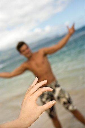 female crotch - Playful couple on beach/ Stock Photo - Premium Royalty-Free, Code: 604-00938447