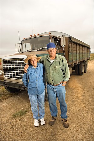 female truck driver - Couple with semi truck/ Stock Photo - Premium Royalty-Free, Code: 604-00939034