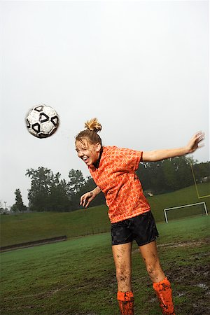 Soccer player heading ball/ Stock Photo - Premium Royalty-Free, Code: 604-00941991