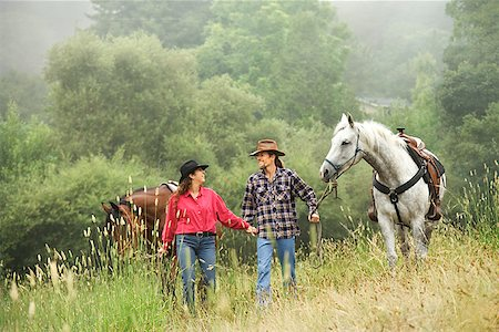 Couple with horses/ Stock Photo - Premium Royalty-Free, Code: 604-01001239