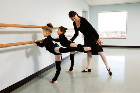 preteen models asian - Ballet instructor helping girls perform an arabesque Stock Photo - Premium Royalty-Free, Code: 604-01119416