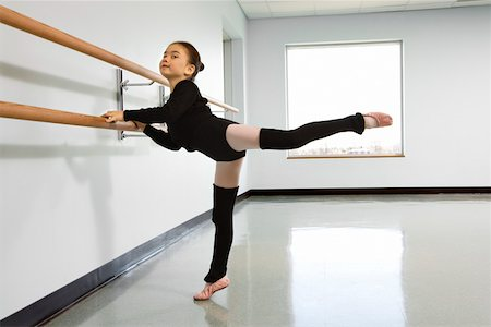 preteen models asian - Girl practicing arabesque at the barre in ballet class Stock Photo - Premium Royalty-Free, Code: 604-01119413