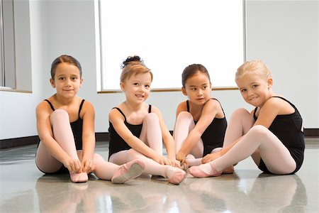 Ballet students adjusting slippers Stock Photo - Premium Royalty-Free, Code: 604-01119425