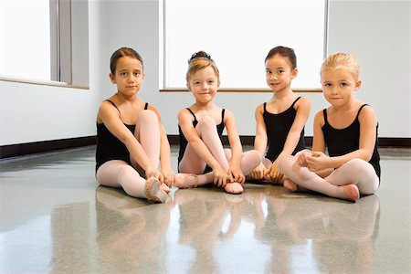 Ballet students adjusting slippers Stock Photo - Premium Royalty-Free, Code: 604-01119426