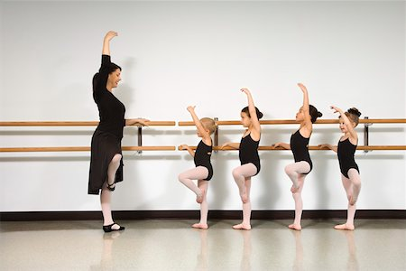preteen models asian - Ballet instructor demonstrating for students standing at the barre Stock Photo - Premium Royalty-Free, Code: 604-01119434