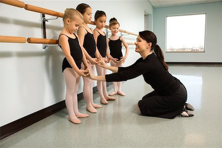 preteen models asian - Ballet instructor correcting students Stock Photo - Premium Royalty-Free, Code: 604-01119436