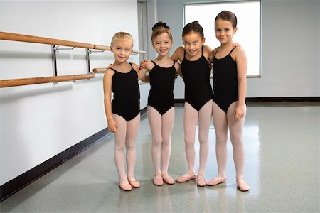 preteen models asian - Portrait of girls in ballet class embracing Stock Photo - Premium Royalty-Free, Code: 604-01119437