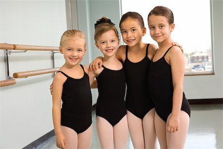 preteen models asian - Portrait of girls in ballet class embracing Stock Photo - Premium Royalty-Free, Code: 604-01119438