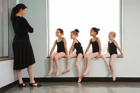 preteen models asian - Ballet instructor addressing students sitting in window Stock Photo - Premium Royalty-Free, Code: 604-01119432